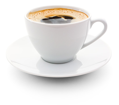 White mug filled with coffee sitting on saucer